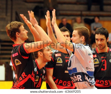 KAPOSVAR, HUNGARY - OCTOBER 15: Kaposvar players at a Middle European League volleyball game Kaposvar (HUN) vs Bled (SLO), October 15, 2010 in Kaposvar, Hungary
