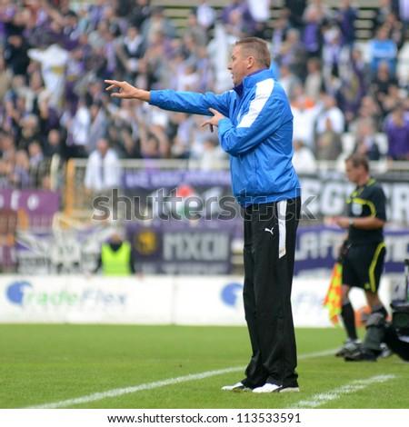 KAPOSVAR, HUNGARY - SEPTEMBER 14: Jos Daerden (Ujpest trainer) in action at a Hungarian Championship soccer game - Kaposvar (white) vs Ujpest (purple) on September 14, 2012 in Kaposvar, Hungary. - stock photo