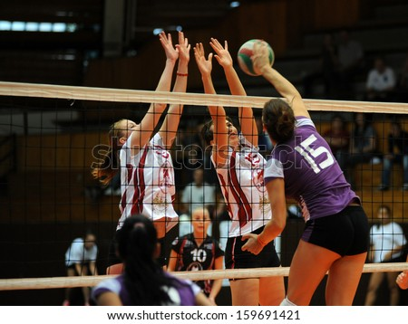 KAPOSVAR, HUNGARY - SEPTEMBER 20: Kata Czina (purple 15) in action at the Hungarian I. League volleyball game Kaposvar (white) vs Ujpest (purple), September 20, 2013 in Kaposvar, Hungary. - stock photo