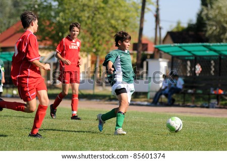 KAPOSVAR, HUNGARY - SEPTEMBER 11: Soma Ozorai (green) in action at the Hungarian National Championship under 15 game between Kaposvar (green)  and Lenti (red) September 11, 2011 in Kaposvar, Hungary.