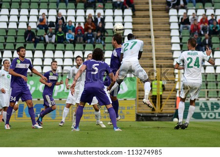 KAPOSVAR, HUNGARY - SEPTEMBER 14: Unidentiified playes in action at a Hungarian National Championship soccer game - Kaposvar (white) vs Ujpest (purple) on September 14, 2012 in Kaposvar, Hungary. - stock photo