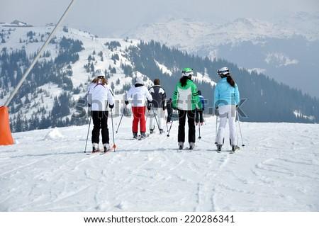 KAPRUN, AUSTRIA - CIRCA MARCH 2012: Unidentified skiers enjoy the last ski week of the season at a mountain lodge in the Zell am See ski resort circa March, 2012 in Zell am See, Austrian Alps - stock photo