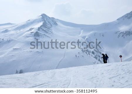 KAPRUN, AUSTRIA - MARCH 3, 2012: Skiers enjoying one of the last ski days of the season, skiing in the Austrian Alps - stock photo