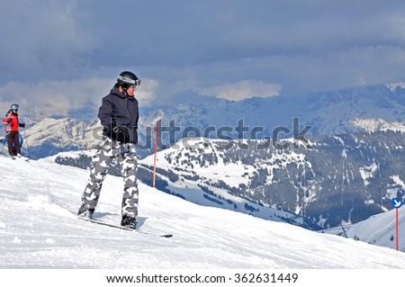KAPRUN - MARCH 9: Unidentified snowboarder snowboarding down the slope in the Austrian Alps. On March 9, 2012, in Kitzsteinhorn, Austria  - stock photo