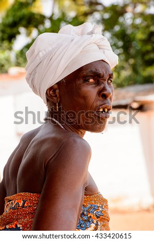 KARA, TOGO - MAR 9, 2013: Unidentified Togolese angry toothless woman in thaditional clothes. People in Togo suffer of poverty due to the unstable econimic situation