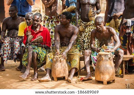 KARA, TOGO - MAR 11, 2012:  Unidentified Togolese drummers make music for the religious voodoo dance performance. Voodoo is the West African religion