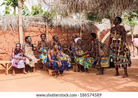 KARA, TOGO - MAR 11, 2012:  Unidentified Togolese people watch the religious voodoo dance. Voodoo is the West African religion