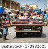 KARA, TOGO - MARCH 11, 2012: Unidentified Togolese people sit in back part of a car in Togo, Mar 11, 2012. People in Togo suffer of poverty due to unstable economical situation - stock photo
