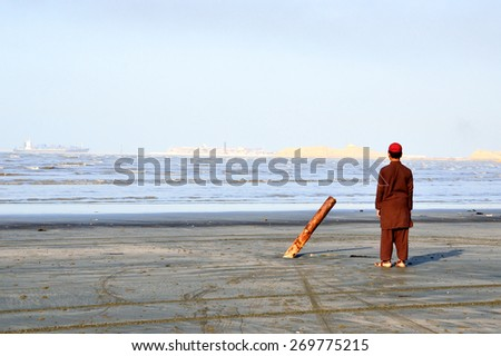 KARACHI - MARCH 30 2015: Clifton Beach is located on the Arabian Sea and it was popular silver-sand beach during twentieth century.But it was affected by an oil spill in 2003. - stock photo