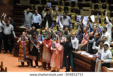 KARACHI, PAKISTAN - AUG 10: MQM members of Sindh Assembly are protesting against extra judicial killing of MQM worker Muhammad Hashim during assembly session on August 10, 2015 in Karachi.