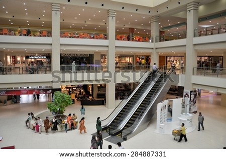 Karachi, Pakistan - August 22, 2012: A view of Karachi's Dolmen City Mall, opened in 2012 and is Pakistan's largest shopping mall. The mall contains many local and international brand label outlets.  - stock photo