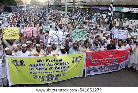 KARACHI, PAKISTAN - DEC 23: Activists of Jamiat-e-Ulema-e-Islam-F are holding protest  demonstration against massacre of Muslims in Yemen, Syria and Burma, on December 23, 2016 in Karachi.