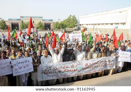 KARACHI, PAKISTAN - DEC 20: Railway employees chant slogans in favor of their demands during protest demonstration at Cantt railway station in Karachi, Pakistan on December 20, 2011. - stock photo