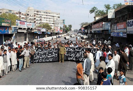 KARACHI, PAKISTAN - DEC 14: Shopkeepers of KMC Market Garden are protesting in favor of their demands during demonstration in Karachi on December 14, 2011 in Karachi, Pakistan. - stock photo