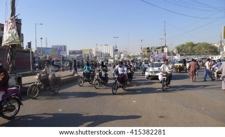 KARACHI, PAKISTAN - FEBRUARY 07: Negligence of traffic police department, large numbers of vehicles are in traffic jam on February 07, 2016 in Karachi.  - stock photo