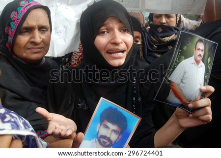 KARACHI, PAKISTAN - JUL 15: Relatives of missing activists of Muttahida Quami Movement (MQM) chant slogans for recovery of their beloveds during protest demonstration on July 15, 2015 in Karachi.