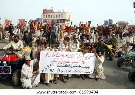 KARACHI, PAKISTAN - JUL 24: Supporters of Seaview Workers Welfare Association are protesting in favor of their demands during demonstration at beach on July 24, 2011in Karachi, Pakistan. - stock photo