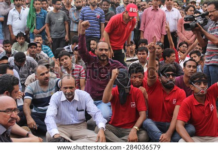 KARACHI, PAKISTAN - JUN 03: Journalists are protesting against license cancellation of  newly upcoming media group BOL Networks, during a on June 03, 2015 in Karachi.
