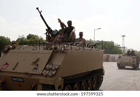 KARACHI, PAKISTAN - JUN 09: Pakistani Army officials leave after an operation against  suspected militants at Jinnah International Airport on June 09, 2014 in Karachi. - stock photo