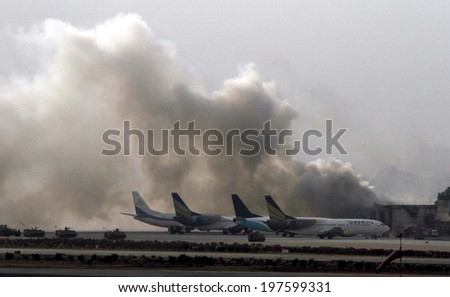 KARACHI, PAKISTAN - JUN 09: Smoke billows from inside the Jinnah International Airport, after suspected Islamic militants attacked the airport,  on June 09, 2014 in Karachi. - stock photo
