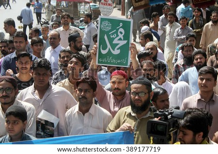 KARACHI, PAKISTAN - MAR 11: Activists of JI are protesting against  execution of Mumtaz Qadri, an ex-police guard who had in January 2011 killed a former  governor on March 11, 2016 in Karachi. - stock photo