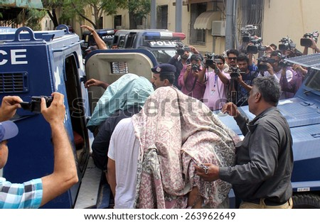 KARACHI, PAKISTAN - MAR 26: Covered faces suspected arrested during a security forces raid at MQM headquarter are being escorting by police to an Anti Terrorism Court, on March 26, 2015 in Karachi.  - stock photo