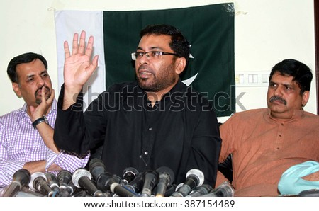 KARACHI, PAKISTAN - MAR 07: Former provincial health minister and MQM leader, Dr Saghir Ahmed addresses to media persons during press conference regarding announcement on March 07, 2016 in Karachi. - stock photo
