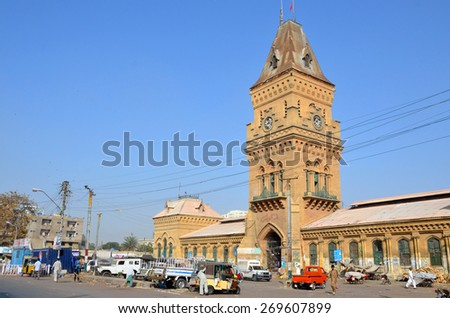 KARACHI , PAKISTAN - MARCH 30 2015:Clock tower at Empress Market was constructed in 1880s and about 140 feet high.It is one of the landmarks in British colonial era.  - stock photo