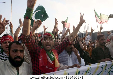KARACHI, PAKISTAN - MAY 14: Supporters of Tehreek-e-Insaf (PTI) chant slogans against alleged rigging in general elections during a protest demonstration at Kimari road on May 14, 2013 in Karachi.