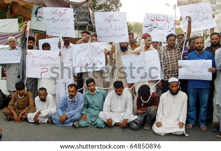 KARACHI, PAKISTAN - NOV 09: Activists of Human Rights Network (HRN) protest in favor of their demands during a demonstration at Karachi press club on 09 November 2010 in Karachi. - stock photo
