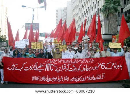 KARACHI, PAKISTAN - NOV 04: Supporters of Labor Party (LPP) shout slogan in favor of their demands during a protest demonstration at Karachi press club on November 04, 2011 in Karachi, Pakistan. - stock photo