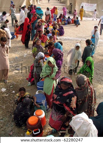 KARACHI, PAKISTAN, SEPT 30: Flood affected people with their drinking water coolers  stand in queues as they are waiting for their turn to get drinking water at water tank at flood affectees relief on September 30, 2010 in Karachi, Pakistan.