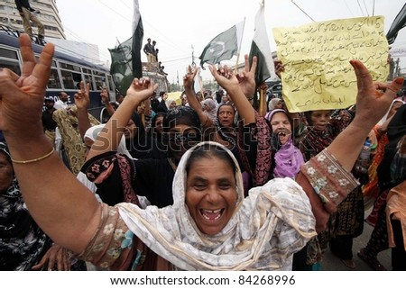 KARACHI, PAKISTAN - SEPT 07: Women residents of Liyari shout slogans in favor of their demands during protest demonstration at Supreme Court registry building in Karachi on September 07, 2011. - stock photo