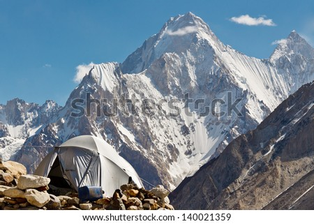 Karakorum Camp, Pakistan, with grand view of Gasherbrum IV - stock photo