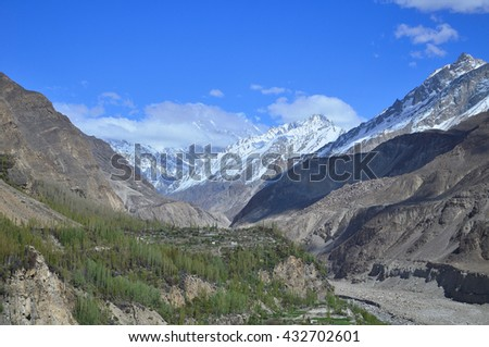 Karakorum range along the way to Hunza valley with blue sky , and some shadow at the mountain , Northern Pakistan - stock photo