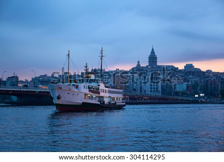 Karakoy and Galata Tower at dawn - stock photo