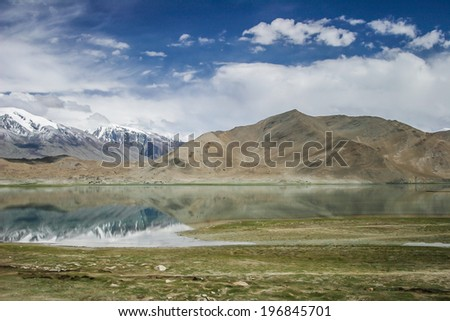 Karakul lake, in  Xinjiang province of China lies on the Karakoram Highway linking Kashgar in China with Islamabad in Pakistan. It's in the Pamir mountain range.