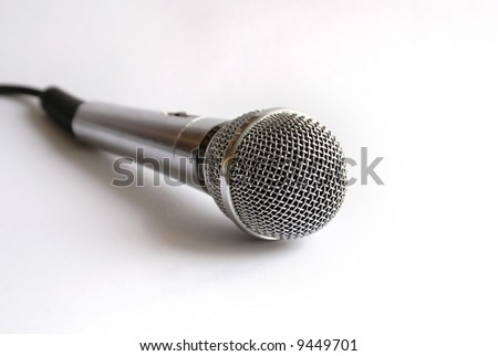 Karaoke microphone on light background