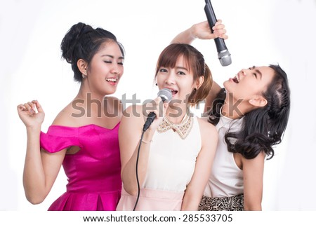 Karaoke ,young girl holding microphone for sing and joy with her music on white background.