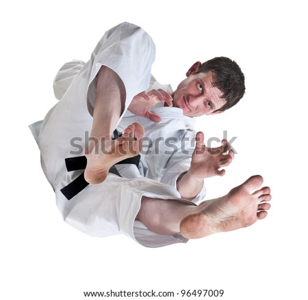 karate.battle blow.Judo.Training fight.figure of sportsman is in a jump.master of hand-to-hand fight on a white background. - stock photo