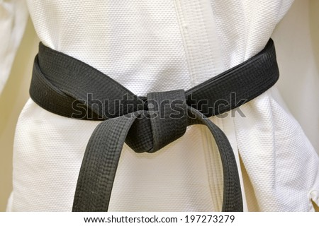 Karate Black Belt on White Uniform - stock photo