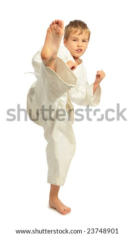 Karate boy kick a leg - stock photo