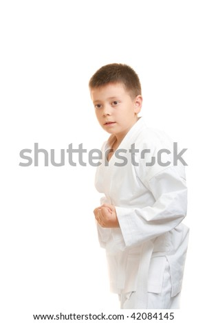 Karate boy with clenched fists sideview photo against white background