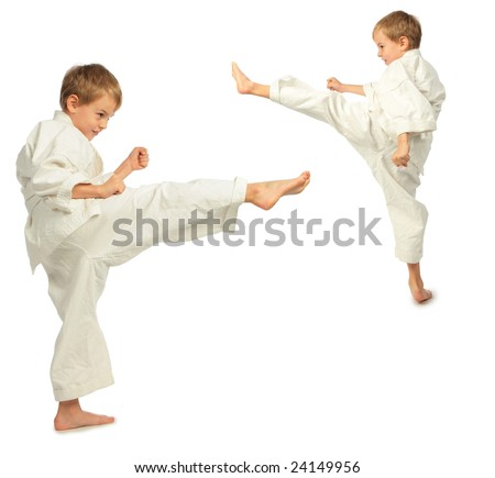 Karate boys kick by foot - stock photo