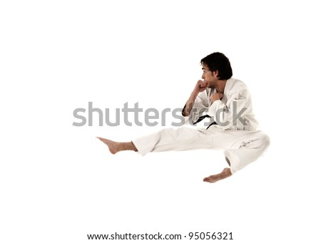 karate flying kick young male fighter isolated on white background. - stock photo