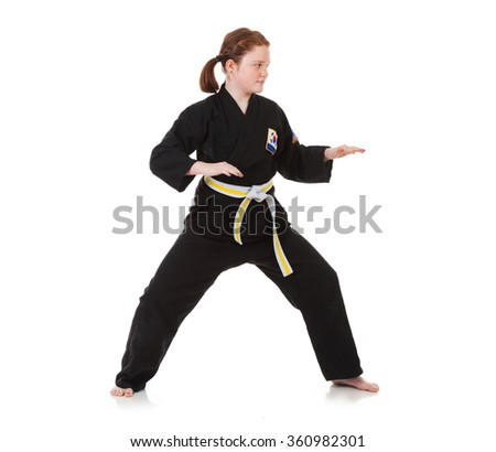 Karate: Girl Stands In Defensive Stance