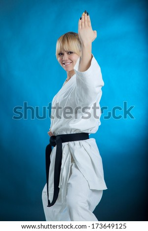 karate girl with black belt posing