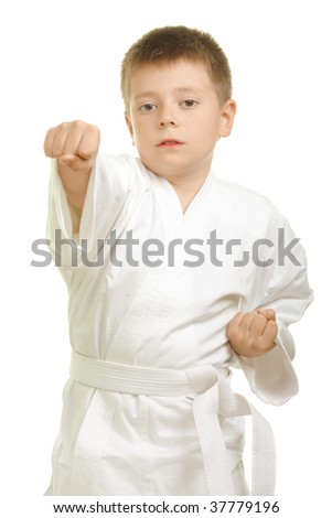 Karate kid showing right fist punch over white background