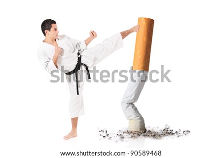 Karate man hitting a cigarette butt isolated against white background - stock photo