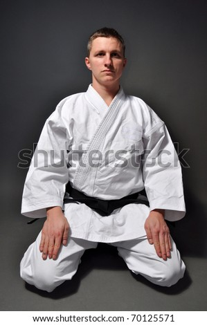 karate man on grey background studio shot - stock photo